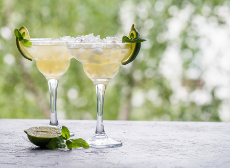 daiquiri alcohol: margarita cocktail with lime on nature background Stock Photo