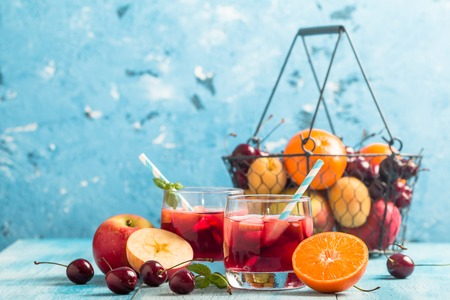 pincher: Refreshing sangria or punch with fruits in glasses and pincher