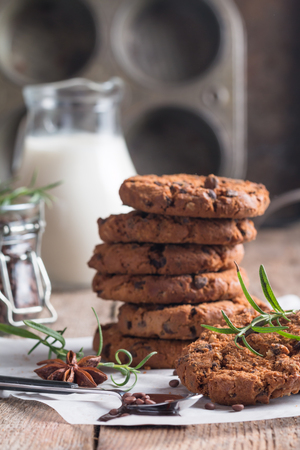 semisweet: Homemade Chocolate Chip Cookies on paper over wooden background Ready to Eat Stock Photo