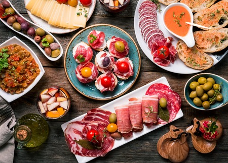 antipasto: spanish tapas and sangria on wooden table, top view Stock Photo