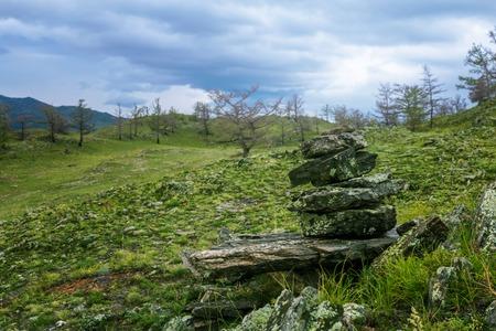 Overcast . Dark coniferous taiga in a mountain. Eastern Siberia. Baikal lake. Maloe more, Russia