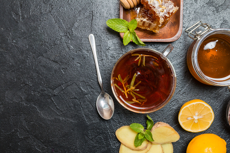 Cup of ginger tea with lemon and honey on slate background, top view with copy space Reklamní fotografie
