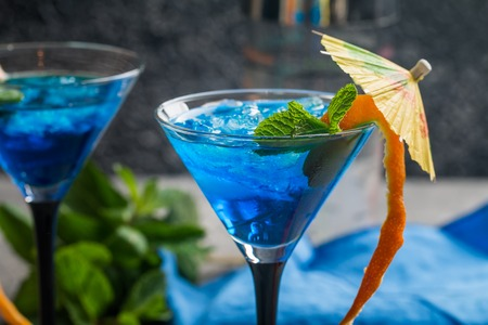 daiquiri alcohol: Blue cocktail with ice Stock Photo