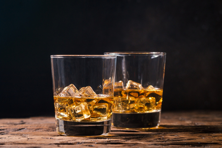 Whiskey with ice in glasses