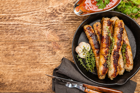 Grilled sausages with sauce