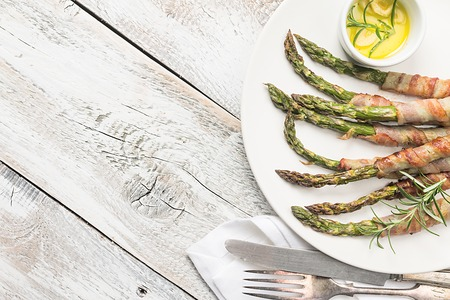 Grilled green asparagus wrapped with bacon Фото со стока