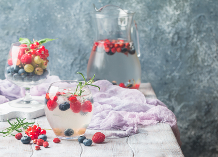infused: Detox fruit infused flavored water with ice. Refreshing summer homemade cocktail with berries