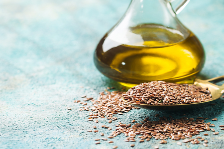 linseed oil: flax seeds and linseed oil Stock Photo
