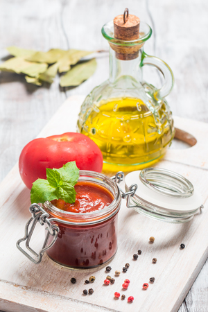 Glass jar with homemade classic spicy tomato sauce