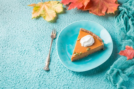 Slice of Festive Homemade Pumpkin Pie with Whipped Cream, top view