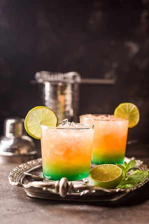 Orange cocktail decorated with lime Stock Photo