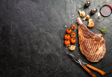 grilled tomahawk beef steak Imagens
