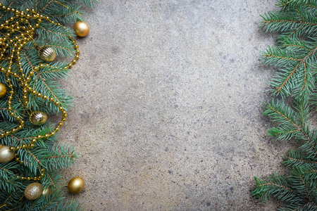 Christmas background with fir tree and decorations. Top view with copy space