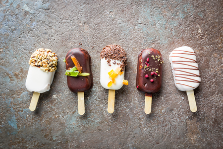 vanilla popsicles with chocolate Stock Photo