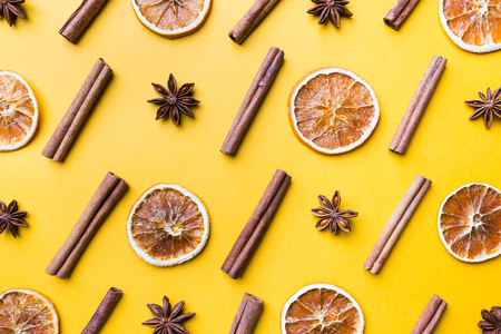 Spices or Mulled wine ingredients on yellow background. Top view, flat lay. Copy space for your text.