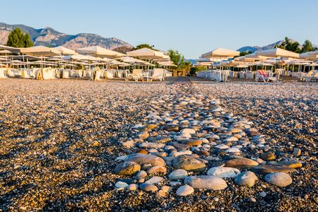 An empty pebble beach on the south coast of Turkey, Kemer in the morning Stok Fotoğraf