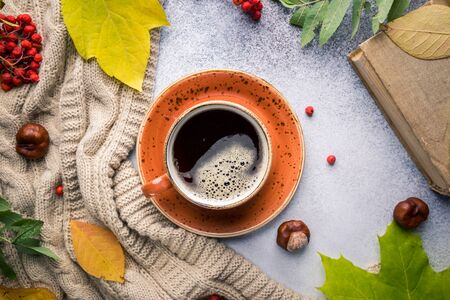 hot coffee and autumn background.