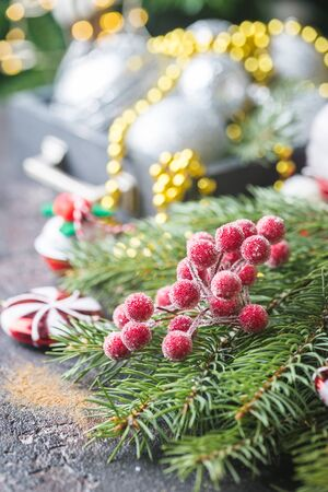 Christmas fir tree with decoration on dark shiny background Banco de Imagens