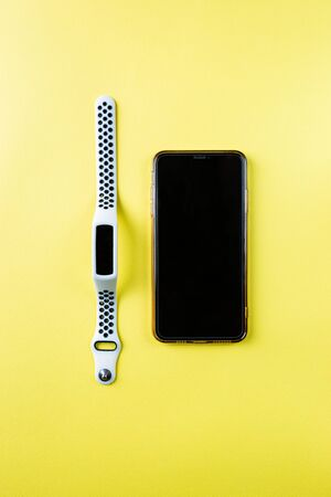 Set of mobile Smart phone and Smart watch on color yellow background, top view Stock Photo