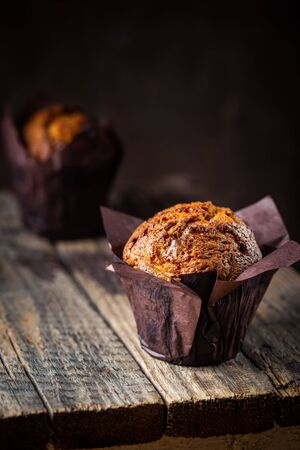 Homemade fresh baked carrot muffins with hazelnut and orange on wooden background Zdjęcie Seryjne