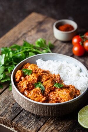 Chicken meat with tikka masala sauce, spicy curry food in a bowl with rice and seasonings Stock Photo