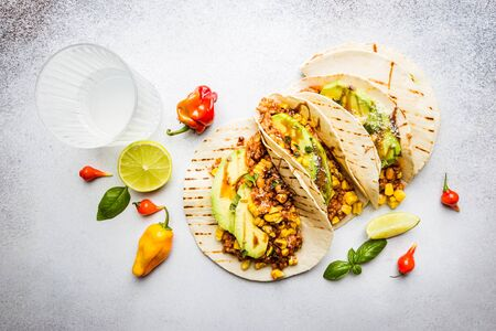 Mexican tacos with meat, beans corn and salsa. Top view