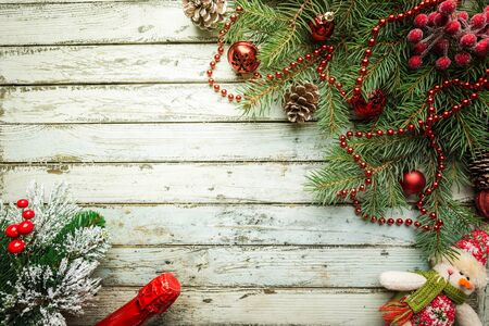 Christmas wooden background with fir tree and decorations. Top view with copy space