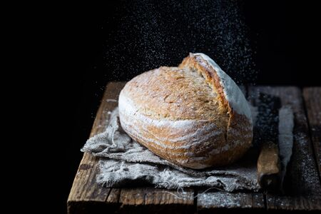 Fresh homemade crisp bread on wooden background. French bread. Bread at leaven. Unleavened bread