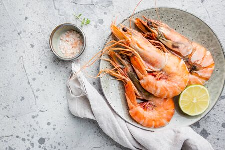 Giant fresh Tiger Prawns on plate over dark stone background, top view Banco de Imagens - 134807322