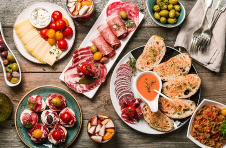 spanish tapas and sangria on wooden table, top view