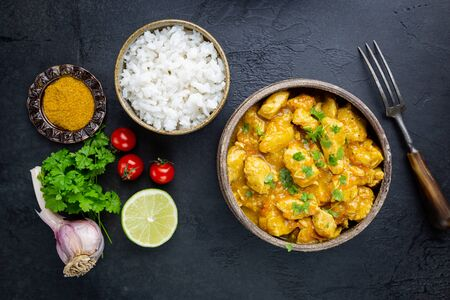 Spicy chicken cooked with curry sauce and rice, top view