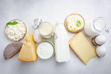 Fresh dairy products, milk, cottage cheese, eggs, yogurt, sour cream and butter on white background, top view 스톡 콘텐츠