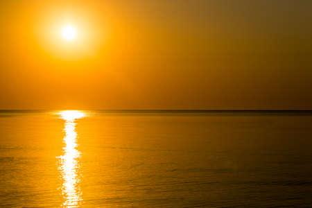 Beautiful sunrise over the horizon in the sea