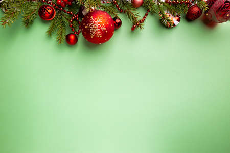 Christmas holidays composition on green background with copy space for your text