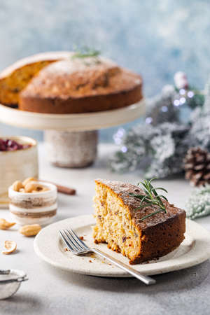 Traditional Christmas cake pudding with fruits and nuts with Christmas decorations, light background