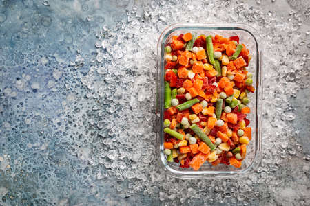 Mixed Frozen various vegetables in a box with ice, top view