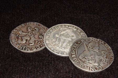 numismatist: old silver coins of Holland from different times Stock Photo