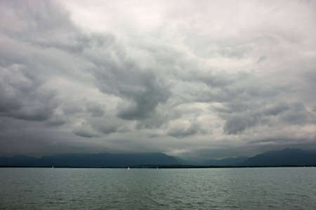 Dark clouds during the stormy weather at Chiemsee lake in Germany.