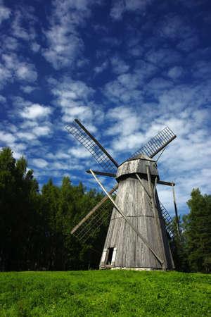 Old windmill in a rural scene, a symbol of ancient alternative energy generation Standard-Bild