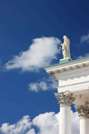 A vertical image with an effect of a statue touching the cloud. Standard-Bild
