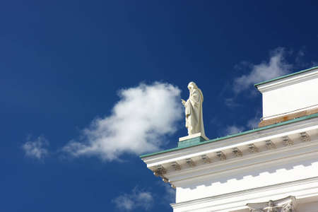 An effect of a statue on a cathedral touching the cloud