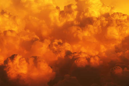 view from above the clouds on a sunlit cloudscape with a boiling effect