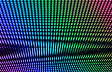 Arrays of LED bulbs on a surface of a contemporary indoor video display. Shallow depth of field.
