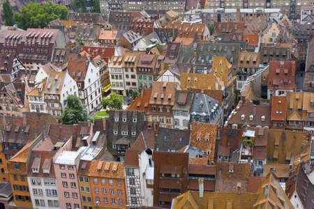 town house: vivid medieval house roofs covered with traditional red and orange tiles in Strasbourg city