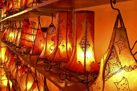 Shelving with antique red and orange glowing lamps Standard-Bild
