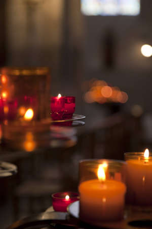 Glass candles glowing in a church. Shallow depth of field.
