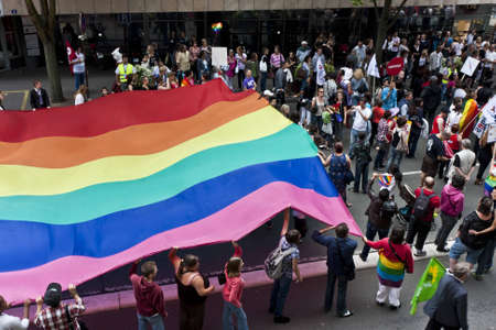 gay pride flag: Le Mans, France - July 9 2011: Love parade for homosexual and lesbian tolerance