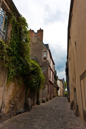 Cute narrow street in a small town in France.