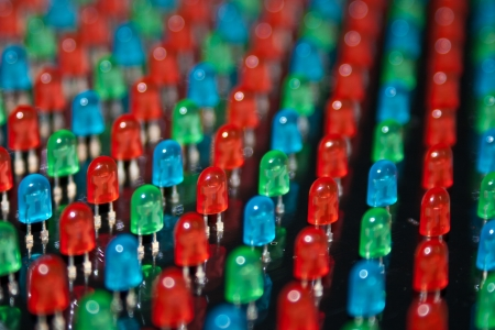 Close up shot of LED lamps during the LED screen manufacturing process. Shallow depth of field for a blurred effect.