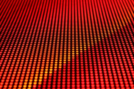 Rows of LEDs showing red light. Shallow depth of field for a blurred effect.